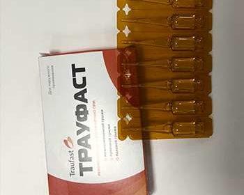Ампулы и упаковка препарата от грыжи Трауфаст